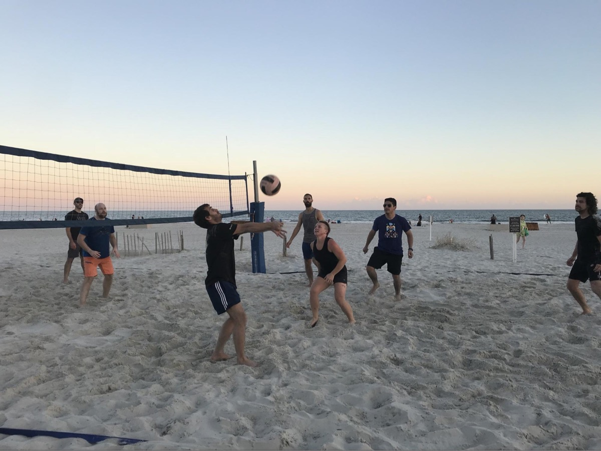 A beach volleyball game at the Fall 2018 company retreat to Hilton Head, SC